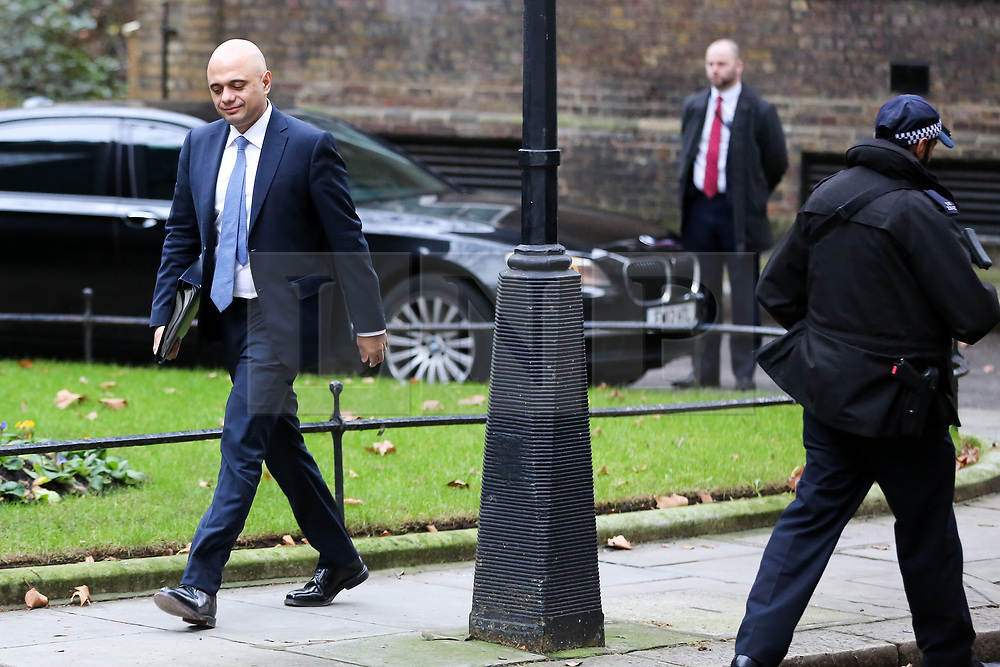 """© Licensed to London News Pictures. 18/12/2018. London, UK. Sajid Javid - Home Secretary arrives in Downing Street for the weekly Cabinet meeting. The Cabinet will discuss the preparations for a """"No Deal"""" Brexit. Photo credit: Dinendra Haria/LNP"""