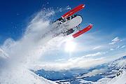 Snowmobiler above the township of Valdez, Alaska, USA. MRA