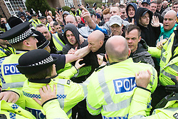 © Licensed to London News Pictures . 04/05/2013 . Leeds , UK . EDL supporters scuffle with police . The English Defence League hold a demonstration in the Moortown housing estate in Leeds over plans to convert a disused pub in to an Islamic Centre . This is the first EDL demonstration in the region since six men were convicted of planning a terrorist attack on an EDL demonstration in Dewsbury . Photo credit : Joel Goodman/LNP