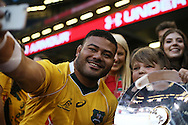 Tolu Latu of Australia poses for a selfie with a young fan who holds the trophy at the end of the game. Under Armour 2016 series international rugby, Wales v Australia at the Principality Stadium in Cardiff , South Wales on Saturday 5th November 2016. pic by Andrew Orchard, Andrew Orchard sports photography
