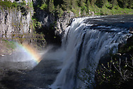 Upper Mesa Falls, on Henry's Fork of the Snake River, plummets 114 feet on Tuesday, June 1, 2021, in the Caribou-Targhee National Forest near Ashton, Idaho. A rainbow seems to compete for attention. (© 2021 Cindi Christie/Cyanpixel)