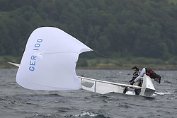 The Flying Dutchman World Championships,  Largs 2014. First days racing in breezy conditions on the Clyde. <br /> <br /> The former Olympic class has attract 40 worldwide competitors to Scotland to compete. <br /> <br /> GER 100, Jans Lechler and Jens Salow<br /> <br /> PIctures Marc Turner / PFM Pictures
