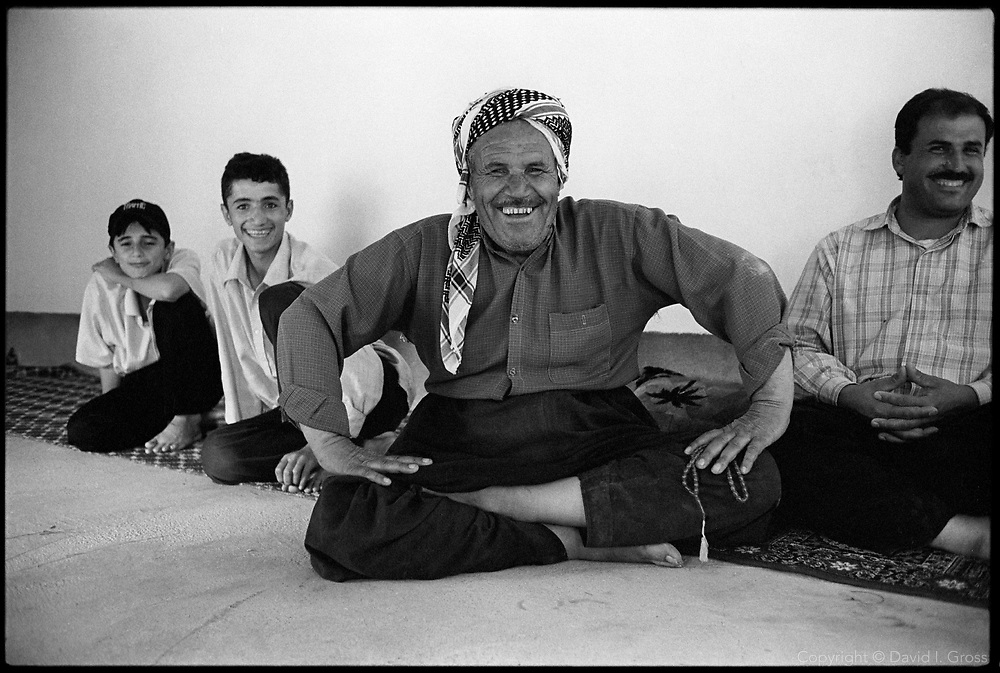Obert Kadr and his son, Sherzad Obert (right), recently returned from Iraqi Kurdistan to their village of Gamish Tapa, Iraq, along with other Kurds. The Arabs fled, and since Kurdish houses were destroyed, the Kurds have taken over the Arab houses. Saddam Hussein's government kicked out the Kurds and replaced them with Arabs in the 1990's.