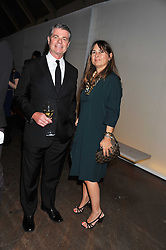Calvin Klein, Inc.'s President & CEO TOM MURRY and ALEXANDRA SHULMAN at a dinner hosted by Calvin Klein Collection to celebrate the future Home of The Design Museum at The Commonwealth Institute, Kensington, London on 13th October 2011.