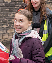 © Licensed to London News Pictures. 28/02/2020. Bristol, UK. Environmental activist GRETA THUNBERG is escorted to a car at the end of the Youth Strike 4 Climate after she spoke to many thousands of people outside Bristol City Hall on College Green followed by a march through the city centre. Greta Thunberg started the Youth Strike 4 Climate protest movement in her home country of Sweden when she sat alone outside the Swedish parliament, eventually paving the way for the Fridays for Future movement across the world. Thousands of people are expected to attend the event in Bristol with many roads closed in the city centre. In 2018 Bristol was the first city to declare a climate emergency and also the first to declare an ecological emergency just four weeks ago. Photo credit: Simon Chapman/LNP.