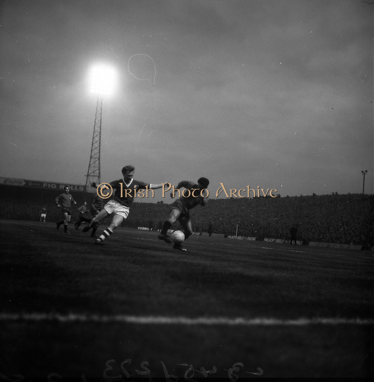 08/04/1964<br /> 04/08/1964<br /> 08 April 1964<br /> European Nations Cup second leg: Ireland v Spain at Dalymount park, Dublin.  Spain beat Ireland 2-0 in the second leg of the European Nations Cup. Picture shows: Rivilla with the ball as Hale of Ireland runs up.