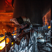 Port Talbot, South Wales. Salamander Tapping of Blast Furnace No 5 Steel worker with specialist hot working gear and thermal lance