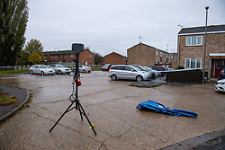© Licensed to London News Pictures. 29/10/2020. Aylesbury, UK. A light and stand next to a cordoned area on Lavric Road, Aylesbury. Thames Valley Police have launched a murder investigation following an incident in Aylesbury. At approximately 21:30GMT on Wednesday 28/10/2020 police officers were called to Lembrook Walk, Aylesbury not far from the Edinburgh Playing Fields following reports that two men had been assaulted. A man in his twenties was taken to hospital with serious injuries where he later died. Photo credit: Peter Manning/LNP