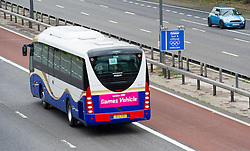 © London News Pictures. 16/07/2012. London, UK. An official Olympics bus moving on to the M4 Olympic lane on July 16, 2012 which opened today. Journeys for Olympic officials and athletes into central London are intended to be eased by the Olympic lane on the M4 motorway, which is the main route in to central London from Heathrow airport. Photo credit: Ben Cawthra/LNP.