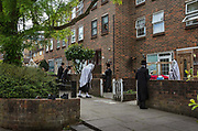 A Sabbath prayer meeting being held outside a Stamford Hill home by ultra orthodox Hassidic Jews during the coronavirus pandemic on 25th April 2020 in London, United Kingdom. The coronavirus has hit Britain's Orthodox Jewish community disproportionately hard, with hundreds in the  tested positive for the coronavirus. Police have become aware of a number of religious meetings like this in the Haredi community who are not taking the restrictions seriously enough and could be endangering themselves and wider society.