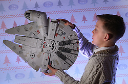 © Licensed to London News Pictures. 04/11/2015. London, UK.  A Millennium Falcon is inspected by Joseph, 11 at the Dream Toys Christmas event. Photo credit: Peter Macdiarmid/LNP