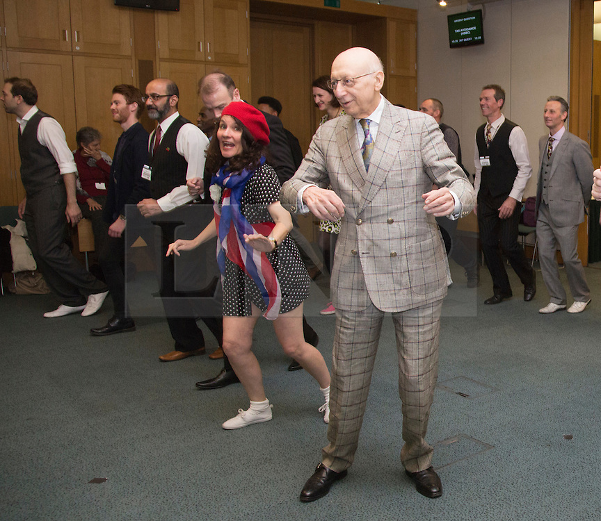 © Licensed to London News Pictures. 23/02/2015. London, England. Sir Gerald Kaufman with members of Dance UK. MPs attend a dance class with members of Dance UK and Lindy Hop dancers. Dance UK launches the 2015 Dance Manifesto with a beginners' social dance class hosted by the All Party Parliamentary Dance Group for all MPs at Portcullis House and led by teacher Jenny Thomas, charleston choreographer for the BBC's Strictly Come Dancing with Strictly professional dancer Robin Windsor. Photo credit: Bettina Strenske/LNP