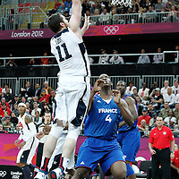 29 July 2012: USA Kevin Love goes for the dunk over Kevin Seraphin of France during the 98-71 Team USA victory over Team France, during the men's basketball preliminary, at the Basketball Arena, in London, Great Britain.