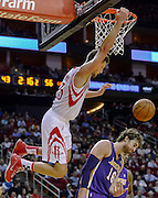 Nov 7, 2013; Houston, TX, USA; Houston Rockets small forward Chandler Parsons (25) dunks over Los Angeles Lakers center Pau Gasol (16) during the second quarter at Toyota Center. Mandatory Credit: Thomas Campbell-USA TODAY Sports