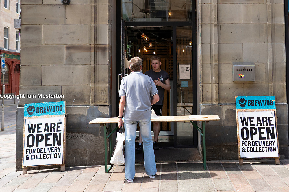 Brewdog pub in Glasgow city centre selling beer at the front door for customers to takeaway, Scotland, UK