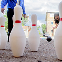 081414       Cable Hoover<br /> <br /> Incoming kindergartner Shyanne Skeet plays a bowling game during the Saint Michael Indian School back to school event Thursday.