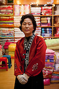 Korean woman in the textile shop at the traditional market in Gongju. This Korean city was the second capital of the Baekje kingdom from AD 475 for 70 years, South Korea, Republic of Korea, KOR, 31 October 2010.