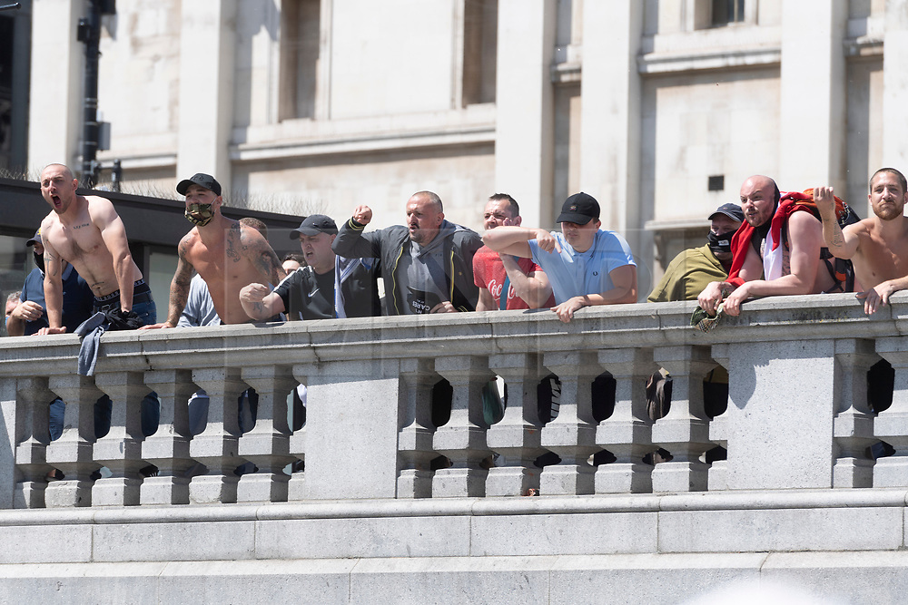 © Licensed to London News Pictures. 13/06/2020. London, UK. Far-Right protesters clash with a small group of Black Lives Matters protesters taking part in a peaceful demonstration in Trafalgar Square. The Metropolitan Police has placed restrictions ahead of the march in order to avoid serious disorder as far-right groups are also demonstrating. Photo credit: Ray Tang/LNP
