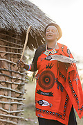 Portrait of local woman dancing while wearing shawl given to her at last Emaganwini, the Marula Festival, Eswatini