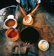 Making naan bread in a clay oven on the street, Lucknow, Uttar Pradesh, India