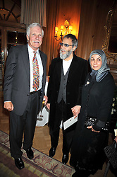Left to right, TED TURNER, YUSUF ISLAM (Cat Stevens) and his wife at the 3rd Fortune Forum Summit held at The Dorchester Hotel, Park Lane, London on 3rd March 2009.