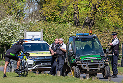 © Licensed to London News Pictures. 21/04/2020. London, UK. Police stop a man on a bike where cycling and driving have been banned in the park since lockdown. Police patrol Richmond Park enforcing lockdown rules with a Police 4x4 buggy which is one of only four originally built for the Olympics and now used during the pandemic in the Royal park for its off-road capabilities. Photo credit: Alex Lentati/LNP