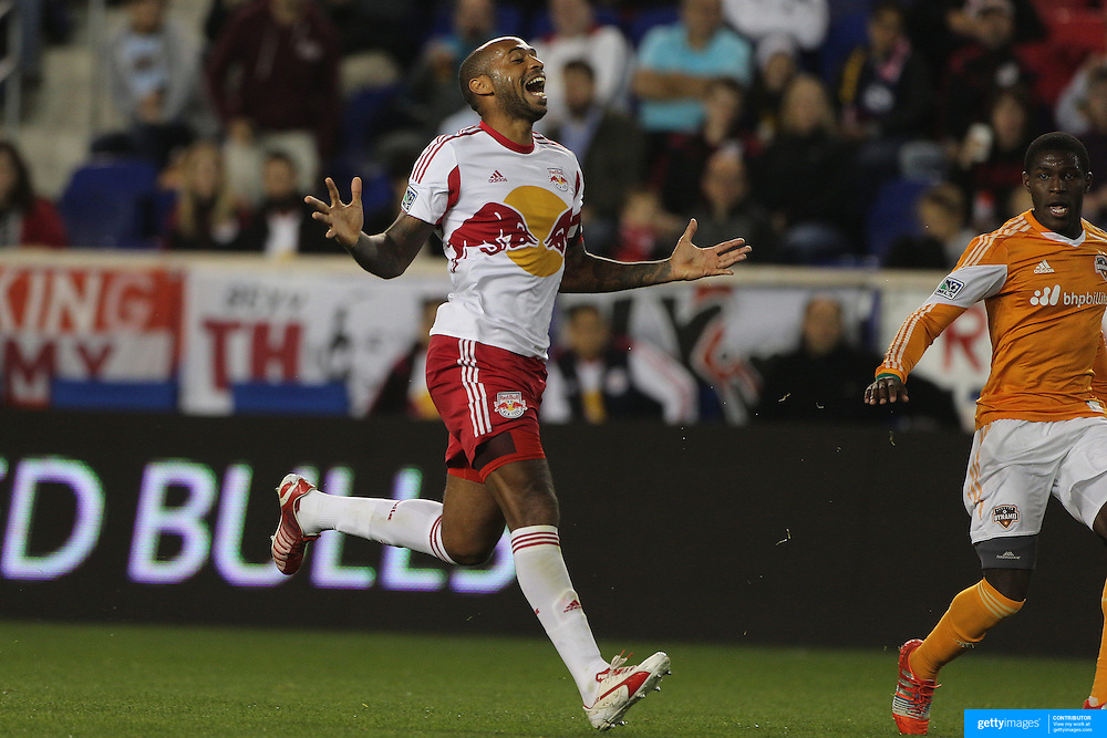 Thierry Henry, New York Red Bulls, reacts to a missed opportunity  during the New York Red Bulls Vs Houston Dynamo, Major League Soccer regular season match at Red Bull Arena, Harrison, New Jersey. USA. 4th October 2014. Photo Tim Clayton