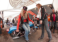 Carolyn Hewitt from Harley Davidson gives instruction to Wendy Schmidt of Connecticut as she uprights a downed motorcycle Tuesday evening.  (Karen Bobotas/for the Laconia Daily Sun)
