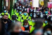 """MET Police march along with demonstrators during a """"Kill the Bill"""" demonstration outside Home Office in central London on Saturday, May 1st, 2021. (Photo/ Vudi Xhymshiti)"""