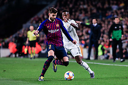 February 6, 2019 - Barcelona, BARCELONA, Spain - 03 Gerard Pique of FC Barcelona and 28 Vinicius of Real Madrid during the semi-final first leg of Spanish King Cup / Copa del Rey football match between FC Barcelona and Real Madrid on 04 of February of 2019 at Camp Nou stadium in Barcelona, Spain (Credit Image: © AFP7 via ZUMA Wire)