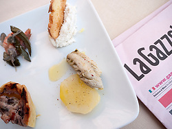 Detail of plate of Cicheti or Venetian tapas snacks at Osterie or bar / restaurant in Venice Italy