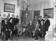 30/09/1954<br /> 09/30/1954<br /> 30 September 1954<br /> <br /> An Taoiseach John A Costello (seated left of painting), presents a painting to sir Chester Beatty (right of painting) on behalf of The Arts Council<br /> Eamon de Valera is present as is Prof Seamus Delargy