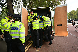 © Licensed to London News Pictures. 07/10/2019. London, UK. Police detain a vehicle belonging to Extinction Rebellion protestors at the back entrance to Downing Street in Westminster . Activists will converge on Westminster blockading roads in the area for at least two weeks calling on government departments to 'Tell the Truth' about what they are doing to tackle the Emergency. Photo credit: Ben Cawthra/LNP