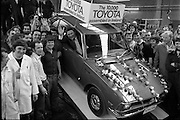 Toyota roll out 10,000th car assembled in Ireland..(L18)..1977..26.05.1977..05.26.1977..26th May 1977..Today saw the rolling out of the 10,000th car to come off the assembly line at Toyota Irl.,Ltd. The car,a Corolla,is part of a range that has made Toyota the fourth best selling range of cars in Ireland...Image shows Mr Tim Mahony,Chairman and Managing Director,Toyota Irl Ltd, surrounded by happy assembly workers as he take the wheel of the 10,000 Toyota  car assembled here.