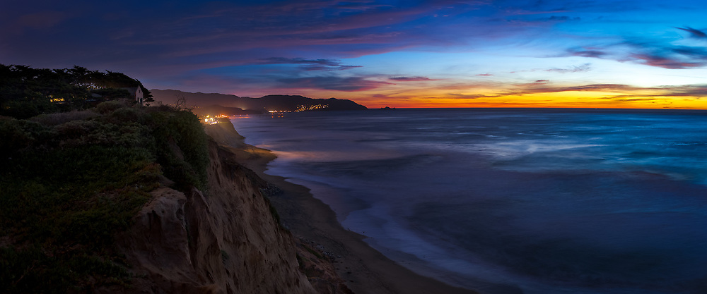 The sun sets over Pacifica, CA. As seen from the cliffs above Manor Beach in the Manor district of Pacifica.