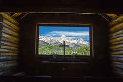 """Church of the Transfiguration. The view out the window of the Grand Tetons is really special. Grand Teton National Park<br /> <br /> For production prints or stock photos click the Purchase Print/License Photo Button in upper Right; for Fine Art """"Custom Prints"""" contact Daryl - 208-709-3250 or dh@greater-yellowstone.com"""