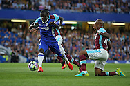 Ngolo Kante of Chelsea runs past Andre Ayew of West Ham United. Premier league match, Chelsea v West Ham United at Stamford Bridge in London on Monday 15th August 2016.<br /> pic by John Patrick Fletcher, Andrew Orchard sports photography.