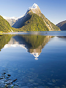 Low-angle, clear view of Mitre Peak from Milford Sound; Fiordland National Park, New Zealand