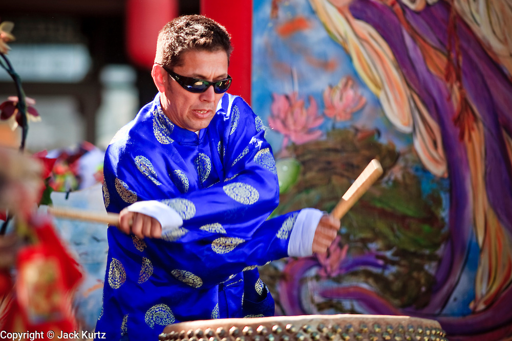"""14 FEBRUARY 2010 - PHOENIX, AZ: A drummer performs at the Chinese New Year celebration in Phoenix, AZ. This marks the Chinese """"Year of the Tiger."""" The Chinese New Year Celebration at the COFCO Chinese Cultural Center in Phoenix attracted thousands of people. The celebration featured traditional Chinese entertainment and food.  PHOTO BY JACK KURTZ"""