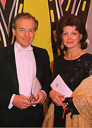 Actress GAYLE HUNNICUTT and her husband MR SIMON JENKINS, at a dinner in London on 27th May 1998.MHX 17