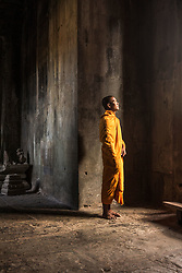 Aug. 2, 2013 - Young Buddhist monk standing inside temple in Angkor Wat, Siem Reap, Cambodia (Credit Image: © Gary  Latham/Cultura/ZUMAPRESS.com)