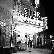 """Y-541124-6.  Night view of Star Theatre, on NW 6th between Burnside and Couch. Marquee says """"Featuring Bonita Secret in Manhaten Revue""""  November 24, 1954"""