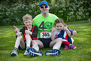 NO FEE PICTURES<br /> 19/5/18 Hundreds of people of all ages lapped up the summer sunshine when they came out to support an important cause which is close to many of their hearts, organ donation, by taking part in the Irish Kidney Association's 'Run for a Life' family fun run which took place at Corkagh Park, Clondalkin, Dublin 22 on Saturday 19th May.   (www.runforalife.ie)  Heart transplant receipiant Ken mulkerrins, with son Conor 9 and daughter kate 6. Picture:Arthur Carron