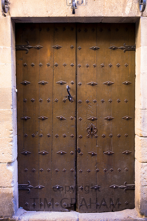 Traditional doorway with metal studs in Calle Mayor in town of Laguardia in Rioja-Alavesa area of Spain