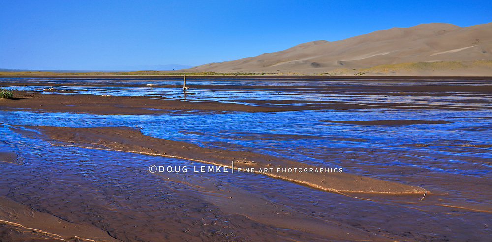Gone by afternoon - An early morning stream flowing through The Great Sand Dunes National Park and Preserve, Colorado; USA