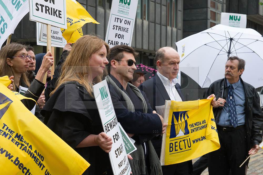 © London News Pictures. 14/05/15. London, UK. A Simon Cowell look a like joins members of the BECTU and the NUJ as they protest outside the ITV AGM in a dispute over pay, Queen Elizabeth II Centre, Westminster, Central London. Photo credit: Laura Lean/LNP