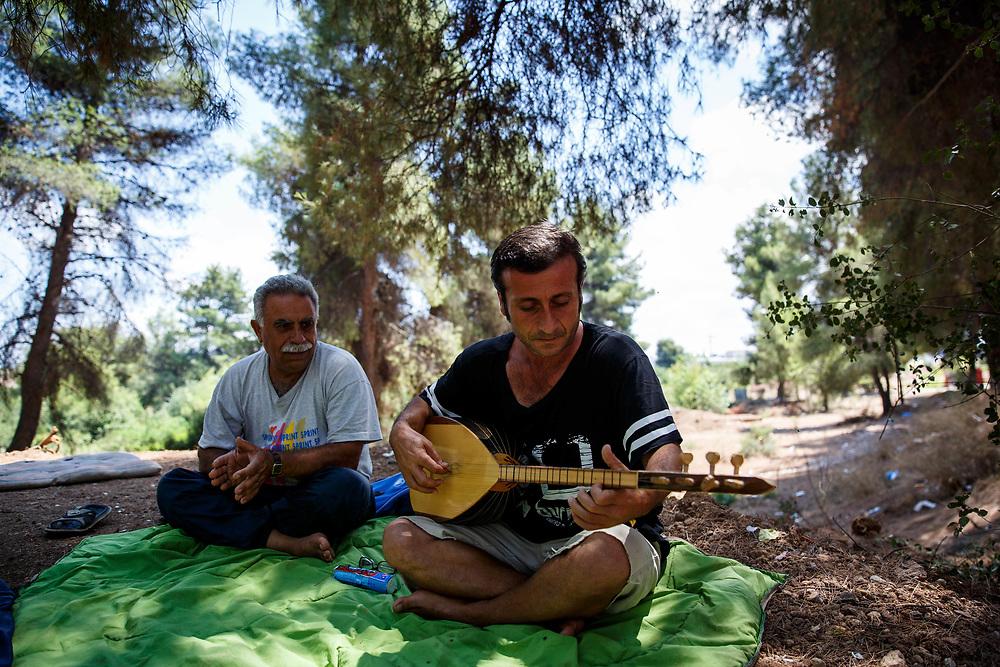 2016 July-Ritsona Refugee Camp, Ritsona, Greece. Adnan, 44, a Kurdish Iraqi refugee performing with his Kurdish Syrian friend, Duju.