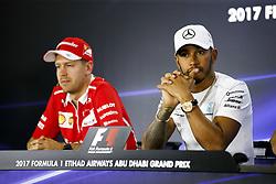 November 23, 2017 - Abu Dhabi, United Arab Emirates - Motorsports: FIA Formula One World Championship 2017, Grand Prix of Abu Dhabi, .#5 Sebastian Vettel (GER, Scuderia Ferrari), #44 Lewis Hamilton (GBR, Mercedes AMG Petronas F1 Team) (Credit Image: © Hoch Zwei via ZUMA Wire)
