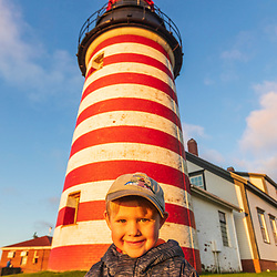 A happy boy at the West Quoddy Head Lighthouse in Lubec, Maine.