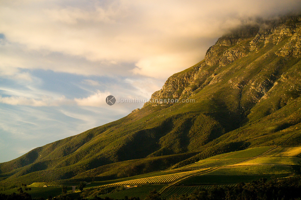 Evening light on the Drakenstein Mountains as seen from Clouds Estate. South Africa. The mountains sit above the Banhoek Valley which is world renown for its wines.